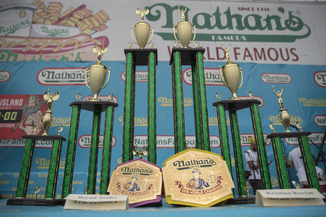 The trophies and champion belts are on display on stage ahead of the Nathan's Famous Fourth of July hot dog eating contest, Wednesday, July 4, 2018, in New York's Coney Island. (AP Photo/Mary Alta ...