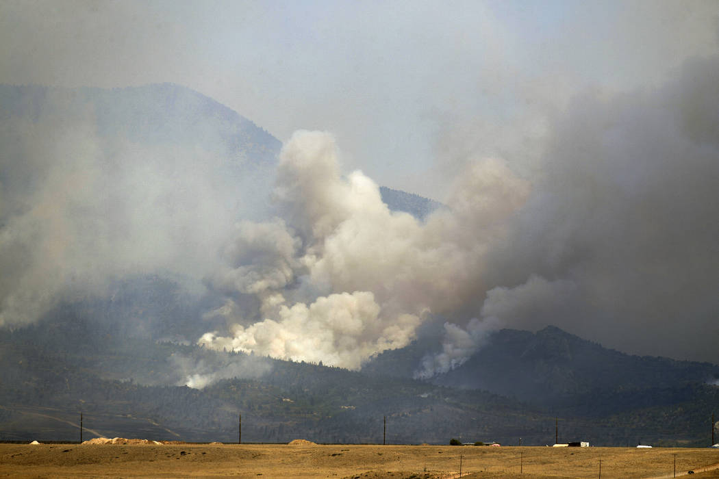 The Spring Creek Fire continues to burn in Costilla County on Tuesday, July 3, 2018 in La Veta, Colo. More than 100 homes in the Colorado mountains were destroyed by a growing wildfire, while hund ...