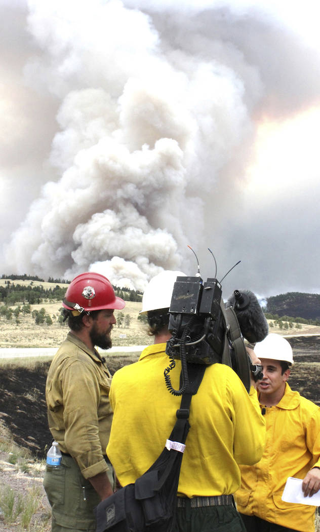 Smoke rises from the Spring Fire as it burns Tuesday, July 3, 2018, near Fort Garland, Colo. The growing wildfire destroyed more than 100 homes in the Colorado mountains, while other blazes across ...