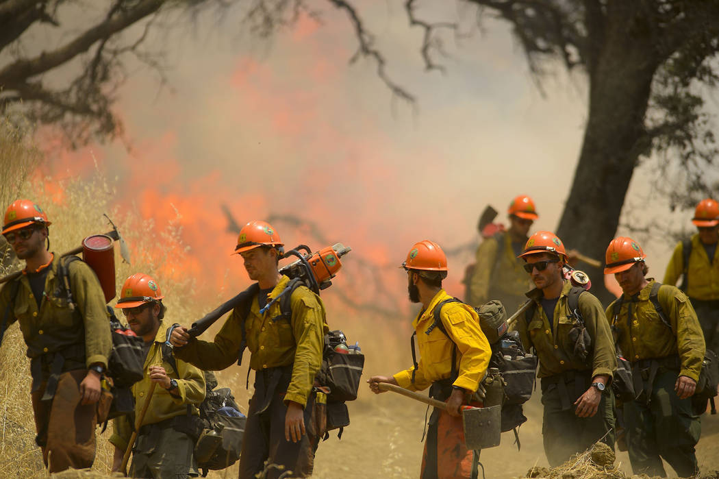 Hot Shot crews from Mendocino use backfires to help contain the County Fire along Highway 129 near Lake Berryessa in Yolo County, Calif., on Tuesday, July 3, 2018. Firefighters have been using air ...