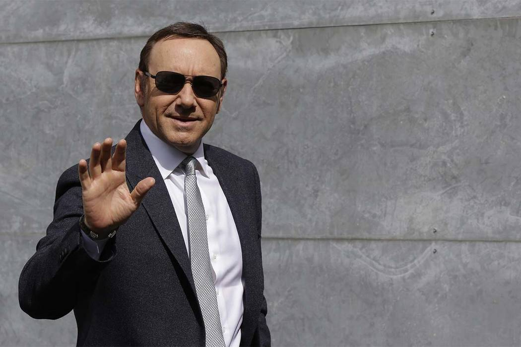 In this file photo dated Tuesday, June 21, 2016, actor Kevin Spacey waves as he arrives to attend the Giorgio Armani men's Spring-Summer 2016-2017 fashion show in Milan, Italy. (Luca Bruno,/AP file)