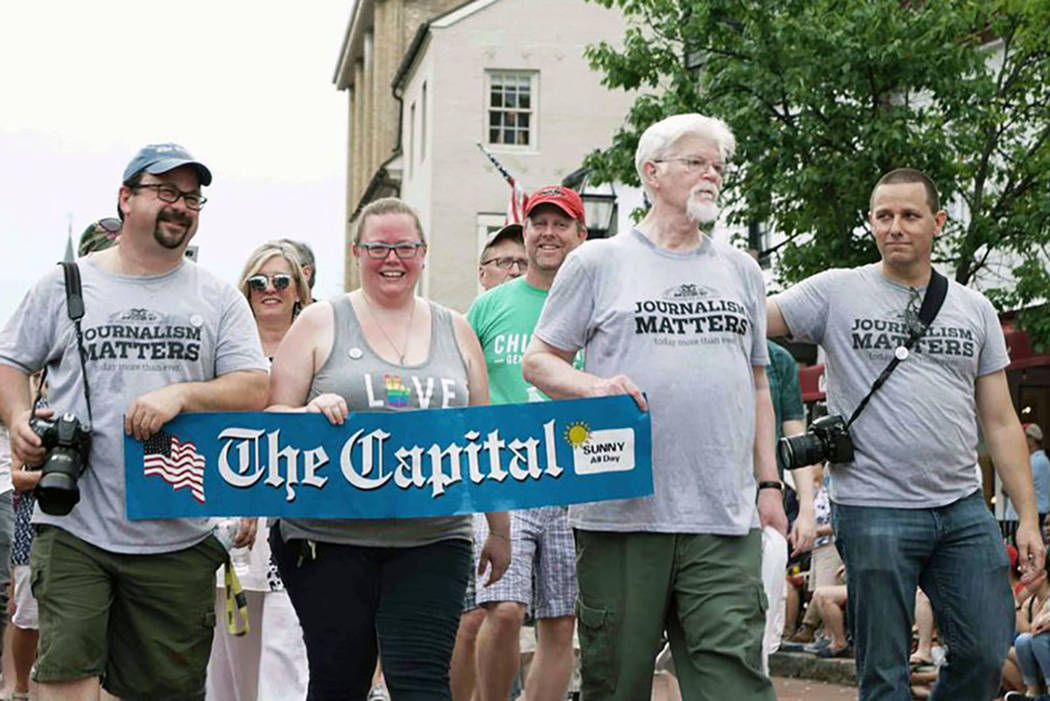 Current and former Capital Gazette staff members march in the Annapolis 4th of July parade in Annapolis, Md., Wednesday, July 4, 2018. (Jay Reed/The Baltimore Sun via AP)