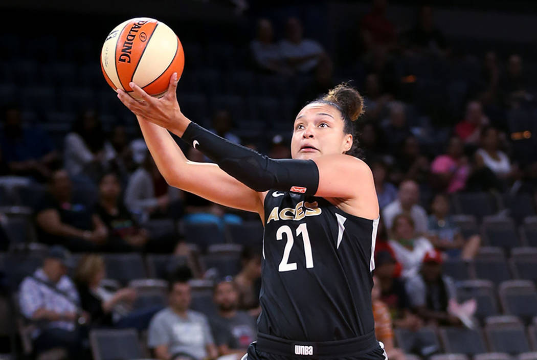 Las Vegas Aces guard Kayla McBride (21) pulls in a long pass in front of New York Liberty guard Sugar Rodgers (14) in the first half of a WNBA basketball game at the Mandalay Bay Events Center in ...