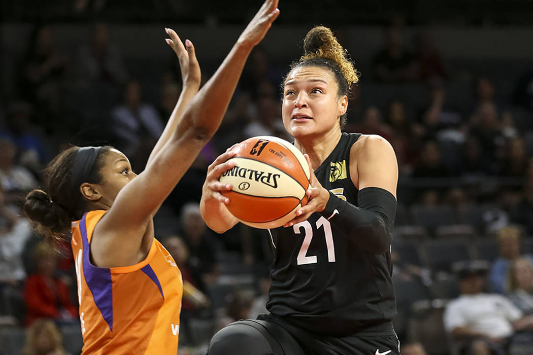 Las Vegas Aces guard Kayla McBride (21) goes up for a shot against Phoenix Mercury forward Camille Little (20) during the second half of a WNBA basketball game at the Mandalay Bay Events Center in ...
