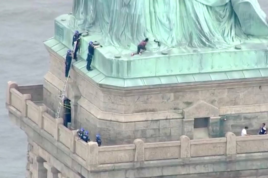 A climber on the Statue of Liberty in New York.