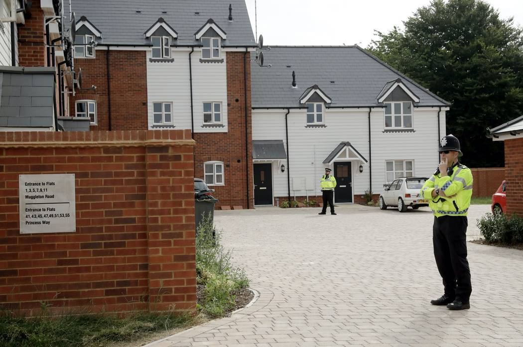 """British police officers stand outside a residential property in Amesbury, England, Wednesday, July 4, 2018. British police have declared a """"major incident"""" after two people were exposed to an unkn ..."""