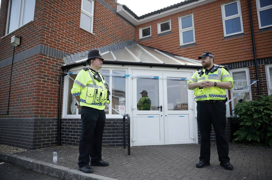 """British police officers guards a cordon outside the Amesbury Baptist Centre church in Amesbury, England, Wednesday, July 4, 2018. British police have declared a """"major incident"""" after two people w ..."""