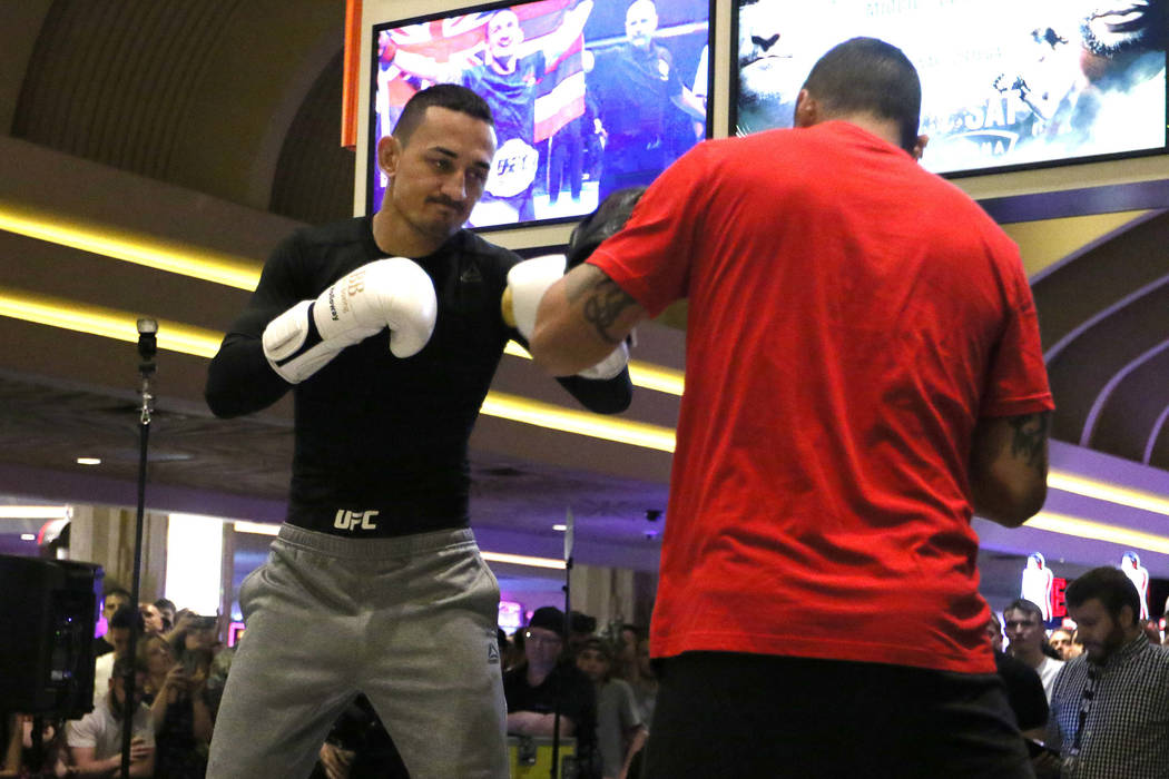 UFC featherweight champion Max Holloway hits mitts during an open workout ahead of UFC 226 at the MGM Grand in Las Vegas, Wednesday, July 4, 2018. Heidi Fang Las Vegas Review-Journal @HeidiFang