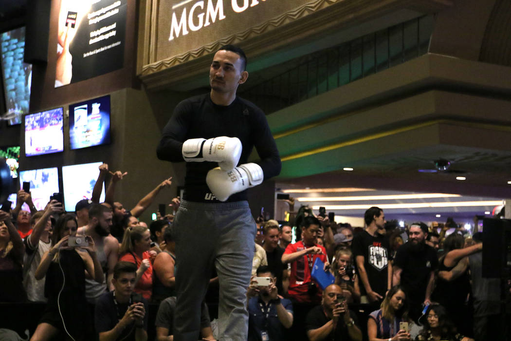 Fans fill the MGM Grand casino floor to watch UFC featherweight champion Max Holloway workout ahead of UFC 226 in Las Vegas, Wednesday, July 4, 2018. Heidi Fang Las Vegas Review-Journal @HeidiFang