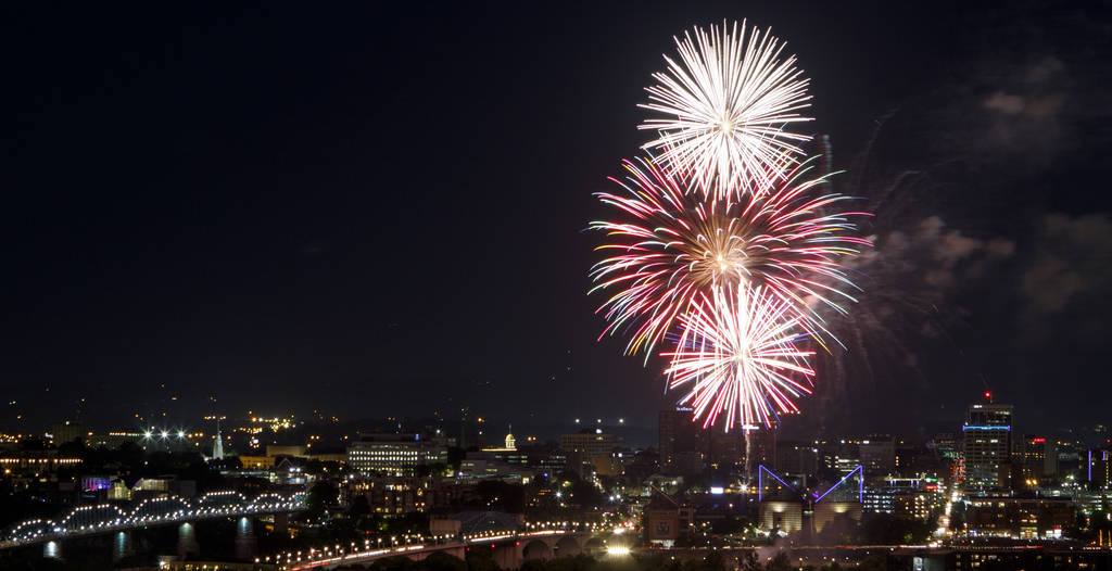 Fireworks from the 2018 Pops on the River Independence Day celebration at Coolidge Park light up the sky over the Tennessee River on Tuesday, July 3, 2018, in Chattanooga, Tenn. The Chattanooga Sy ...