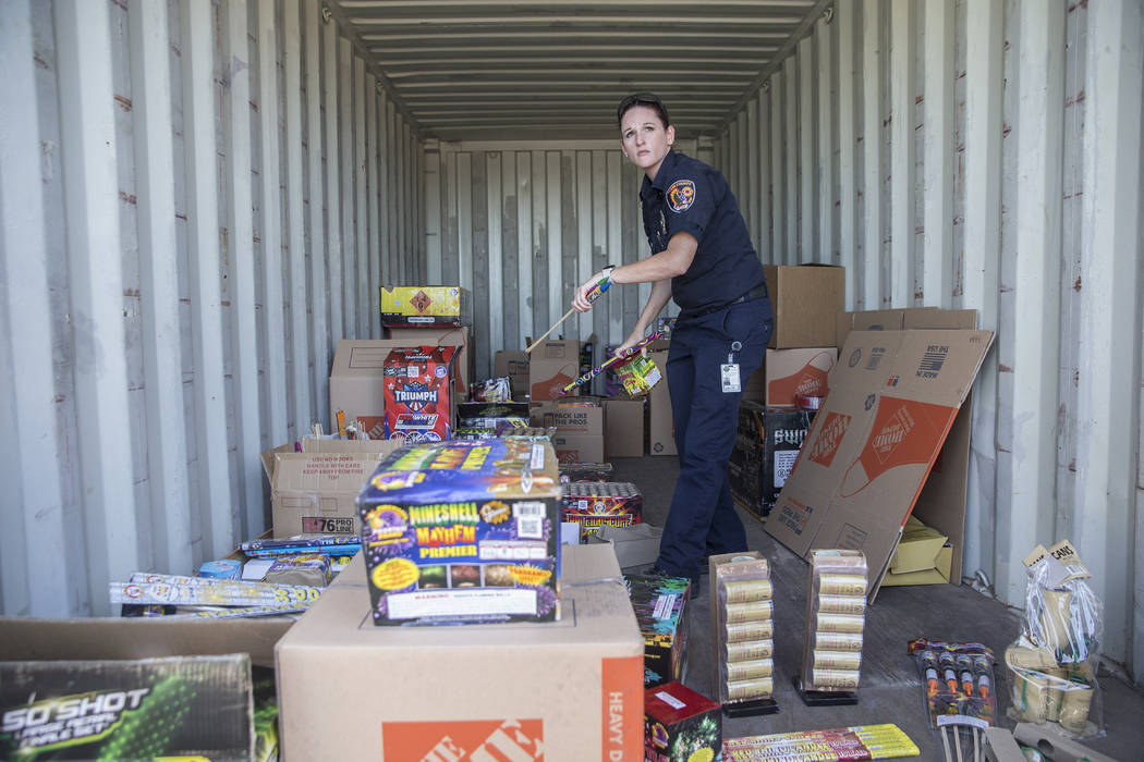 Amanda Wildermuth, with Clark County Fire Prevention, organizes confiscated illegal fireworks taken during the Fourth of July on Thursday, July 5, 2018, at Clark County Fire Station 22, in Las Veg ...