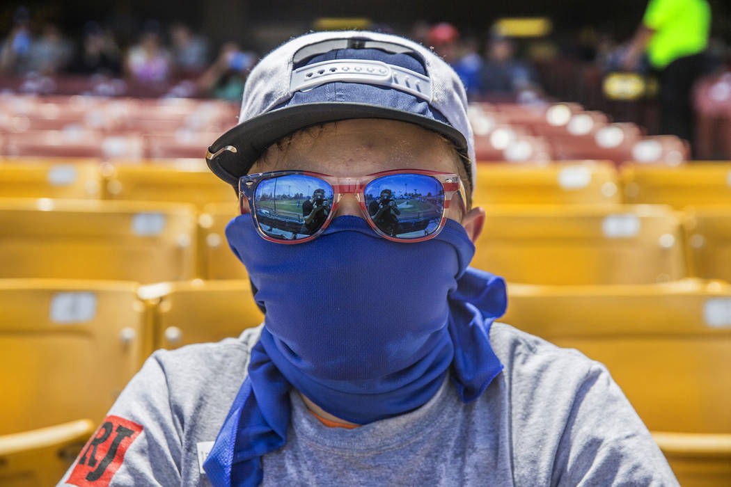 Baseball fan T.J. Leger protects himself from the sun during a Las Vegas 51s game at Cashman Field in Las Vegas. (Benjamin Hager/Las Vegas Review-Journal) @benjaminhphoto