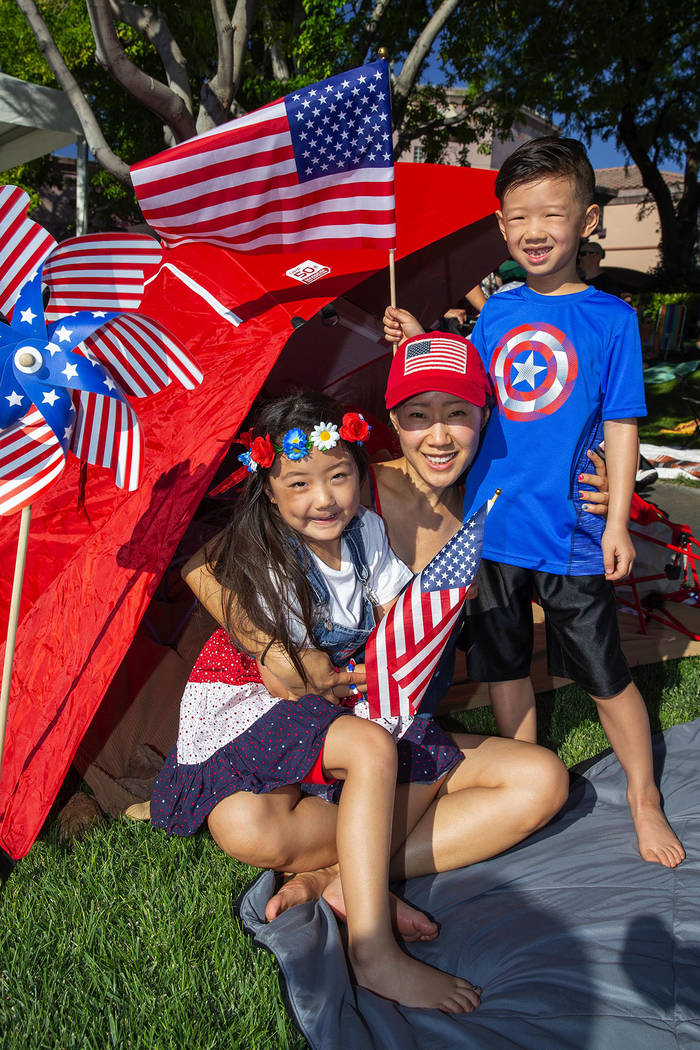 From left, Tenley, 5; Connie Chow; and Jace Chow, 7, attend the annual Summerlin Council Patriotic Parade. (Summerlin Council – Studio J, Eric Jamison)