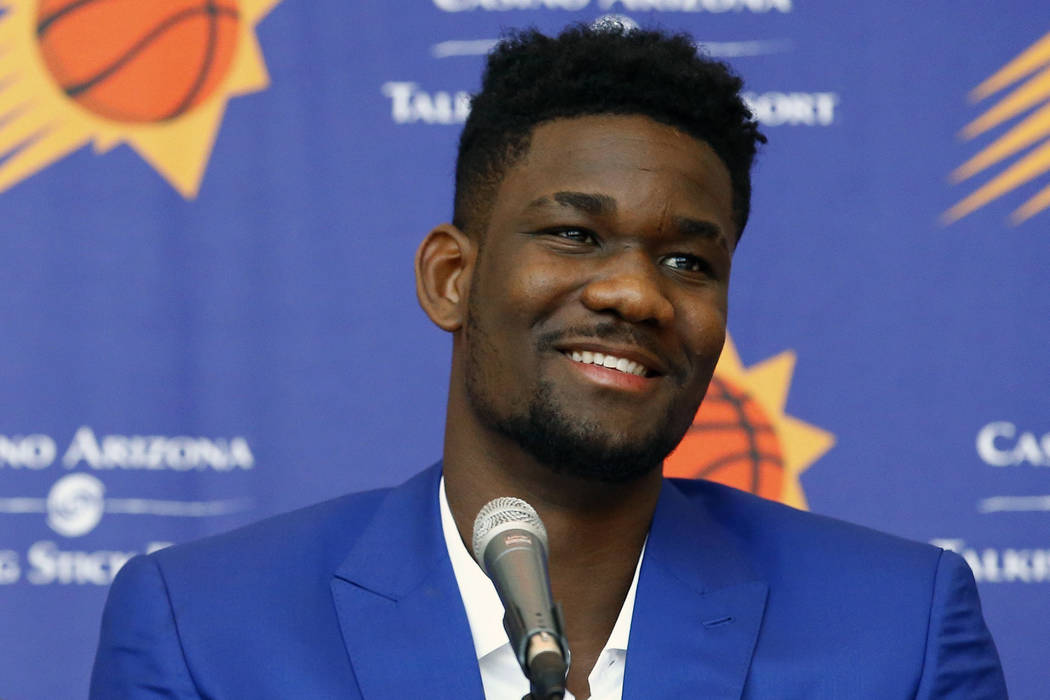 In this June 22, 2018, file photo, Phoenix Suns No. 1 draft pick Deandre Ayton laughs during an introductory press conference in Phoenix. (AP Photo/Ross D. Franklin, File)