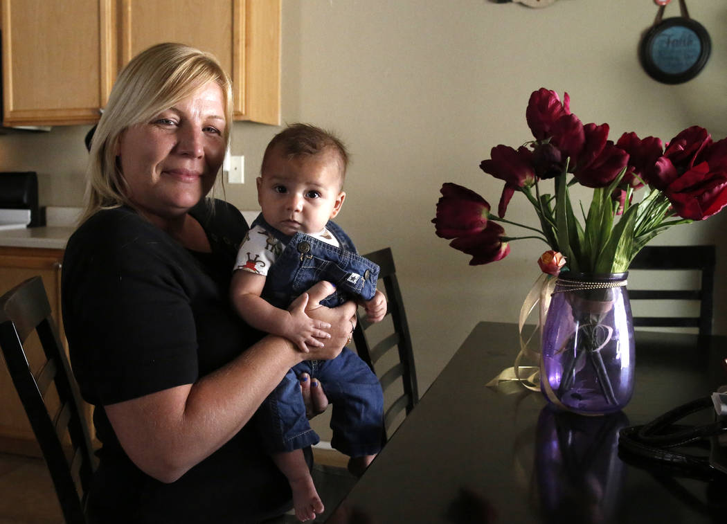Jennifer Stanert and her 5-month-old son Avery Carrasco pose for photo at her Las Vegas home on Thursday, June 28, 2018. Bizuayehu Tesfaye/Las Vegas Review-Journal @bizutesfaye