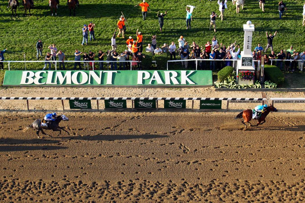 Jun 6, 2015; Elmont, NY, USA; American Pharoah (5) finishes ahead of Frosted (6) to win the 2015 Belmont Stakes at Belmont Park. American Pharoah won all three legs of the Triple Crown. Mandatory ...