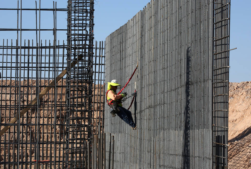 A construction worker is tying rebar to make a newly constructed footing frame at the construction site of the new Las Vegas ballpark on Thursday, June 7, 2018, in Summerlin. Bizuayehu Tesfaye/Las ...