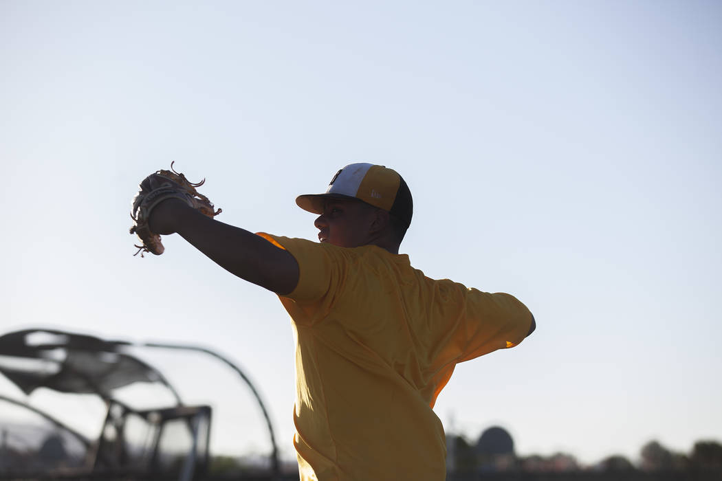 Bonanza High School's Makai DeSoto throws the ball during drills at baseball practice at Bonanza High School in Las Vegas, Tuesday, July 3, 2018. Rachel Aston Las Vegas Review-Journal @rookie__rae