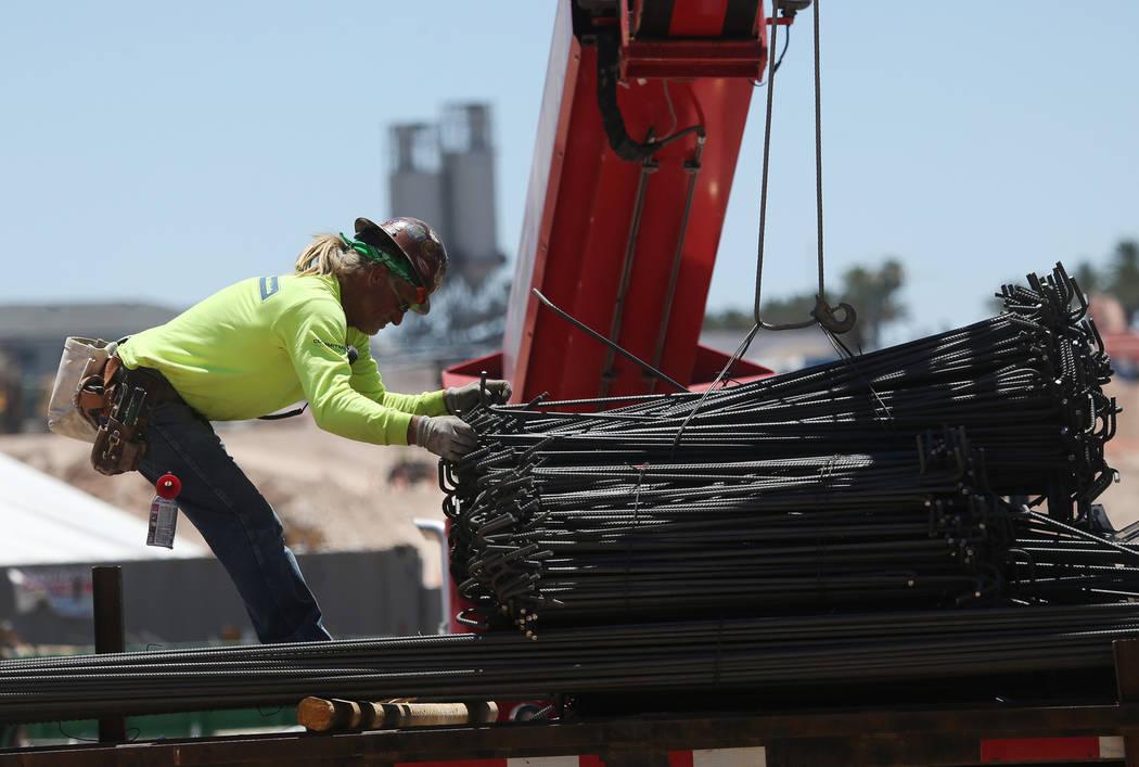 A worker moves steel on the construction site for the future Raiders stadium in Las Vegas, Thursday, June 28, 2018. Erik Verduzco Las Vegas Review-Journal @Erik_Verduzco
