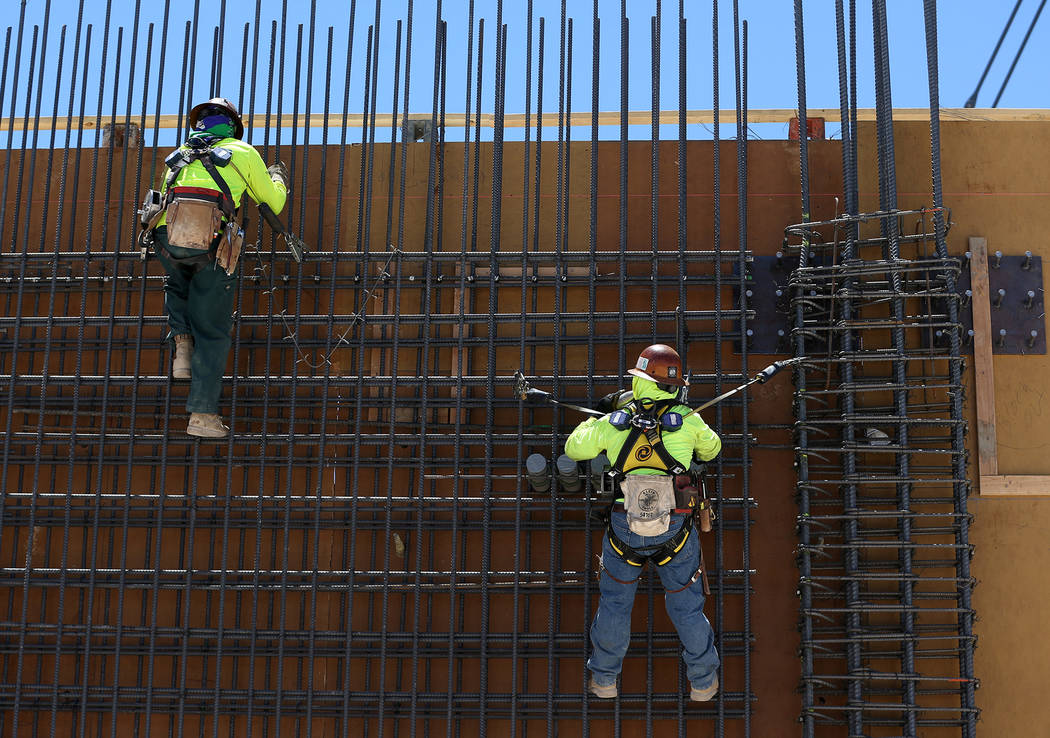 Workers hang from a steel wall on the construction site for the future Raiders stadium in Las Vegas, Thursday, June 28, 2018. Erik Verduzco Las Vegas Review-Journal @Erik_Verduzco