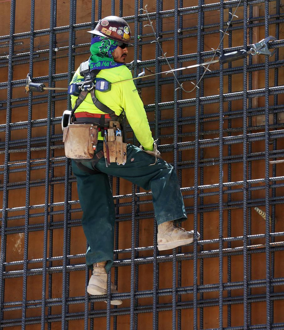 The workers hangs from a steel wall on the construction site for the future Raiders stadium in Las Vegas, Thursday, June 28, 2018. Erik Verduzco Las Vegas Review-Journal @Erik_Verduzco