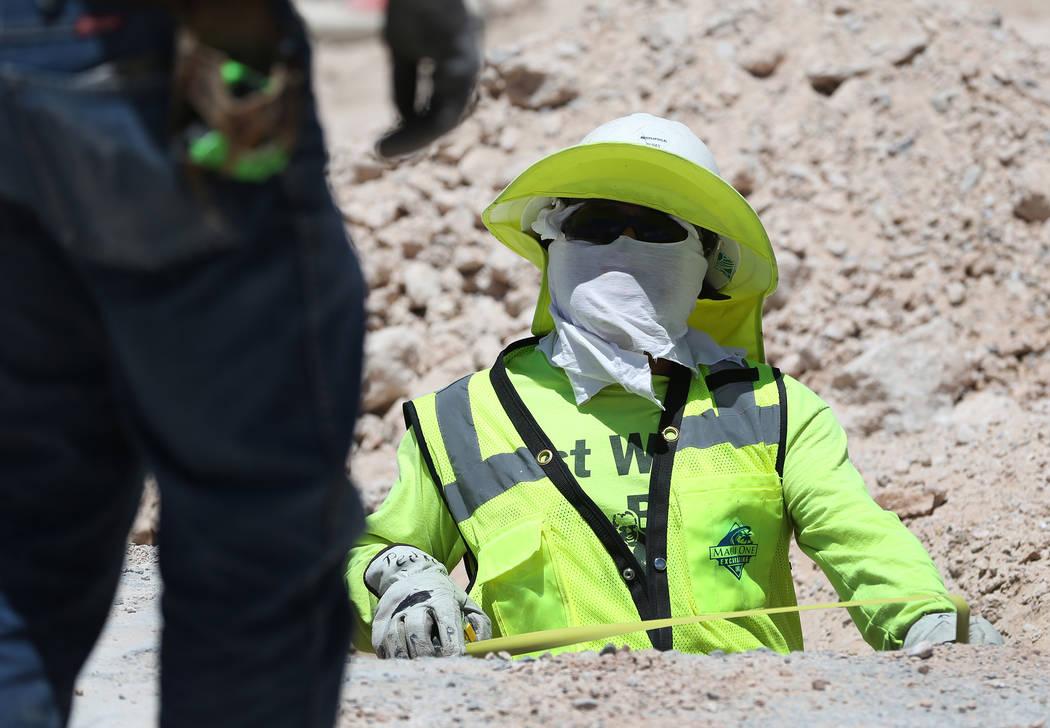 A worker takes measurements on the construction site for the future Raiders stadium in Las Vegas, Thursday, June 28, 2018. Erik Verduzco Las Vegas Review-Journal @Erik_Verduzco