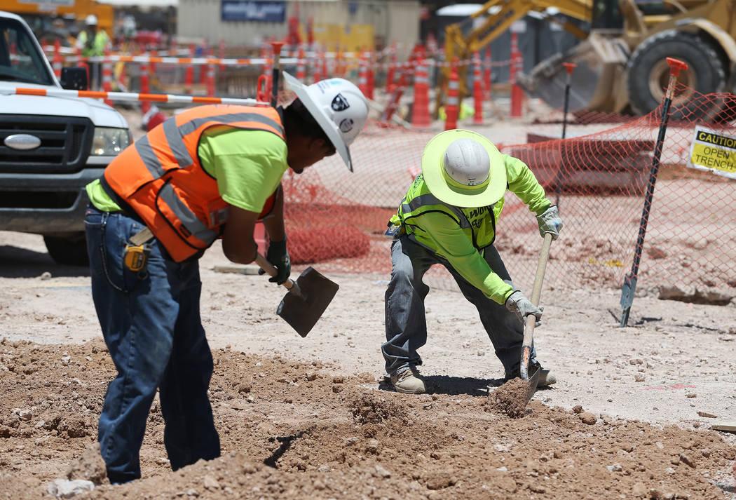 Workers shovel dirt on the construction site for the future Raiders stadium in Las Vegas, Thursday, June 28, 2018. Erik Verduzco Las Vegas Review-Journal @Erik_Verduzco