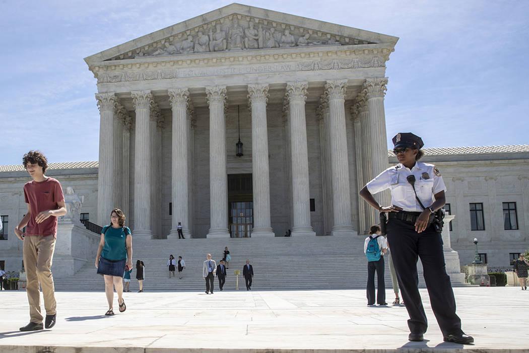 Visitors depart the Supreme Court early Monday, June 25, 2018. (AP Photo/J. Scott Applewhite)