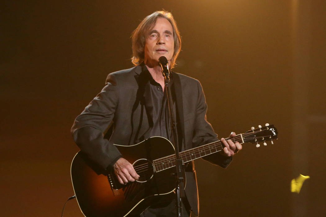 """Jackson Browne performs """"Take It Easy"""" during a tribute to Glenn Frey at the 58th annual Grammy Awards on Monday, Feb. 15, 2016, in Los Angeles. (Photo by Matt Sayles/Invision/AP)"""