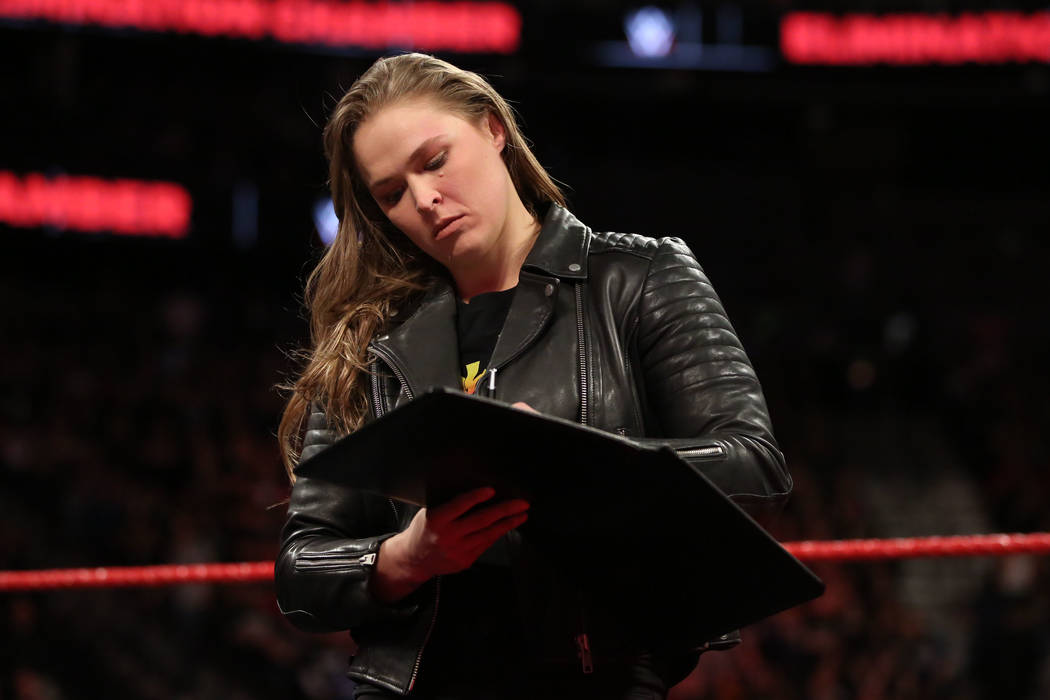 Ronda Rousey signed her WWE contract at T-Mobile Arena on Sunday. (WWE)
