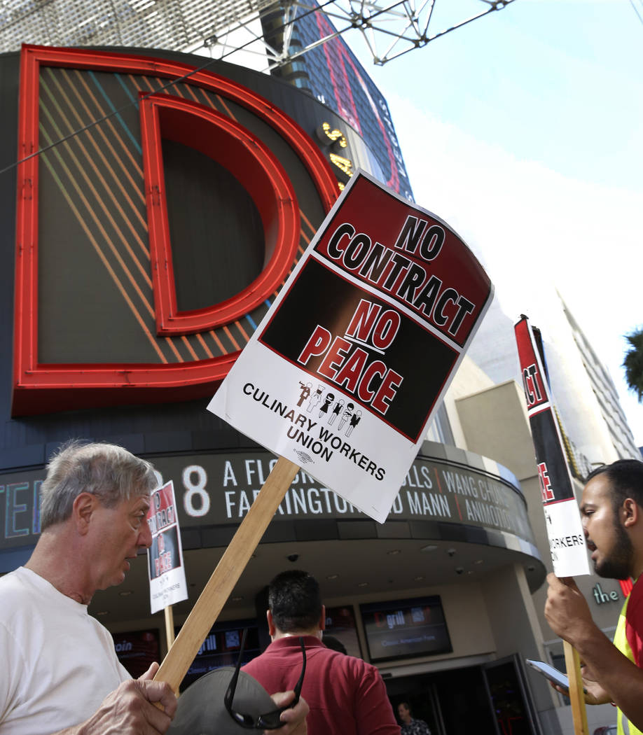 Culinary union members picket in front of the D Las Vegas on Friday, July 6, 2018, in downtown. (Bizuayehu Tesfaye/Las Vegas Review-Journal) @bizutesfaye