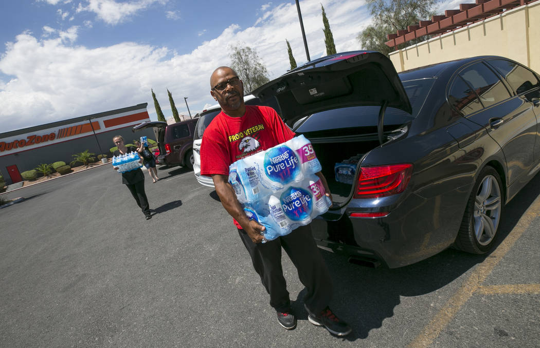 Las Vegas resident Randy Davis makes a water donation to Metro Pizza during a water bottle drive, Thursday, July 27, 2017, at the pizzeria located at 6720 Sky Pointe Drive in Las Vegas. Richard Br ...