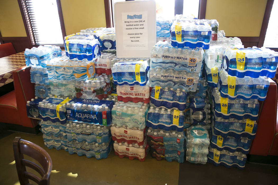 Bottled water donations at Metro Pizza located at 6720 Sky Pointe Drive during their water bottle drive, Thursday, July 27, 2017, in Las Vegas. Richard Brian Las Vegas Review-Journal @vegasphotograph