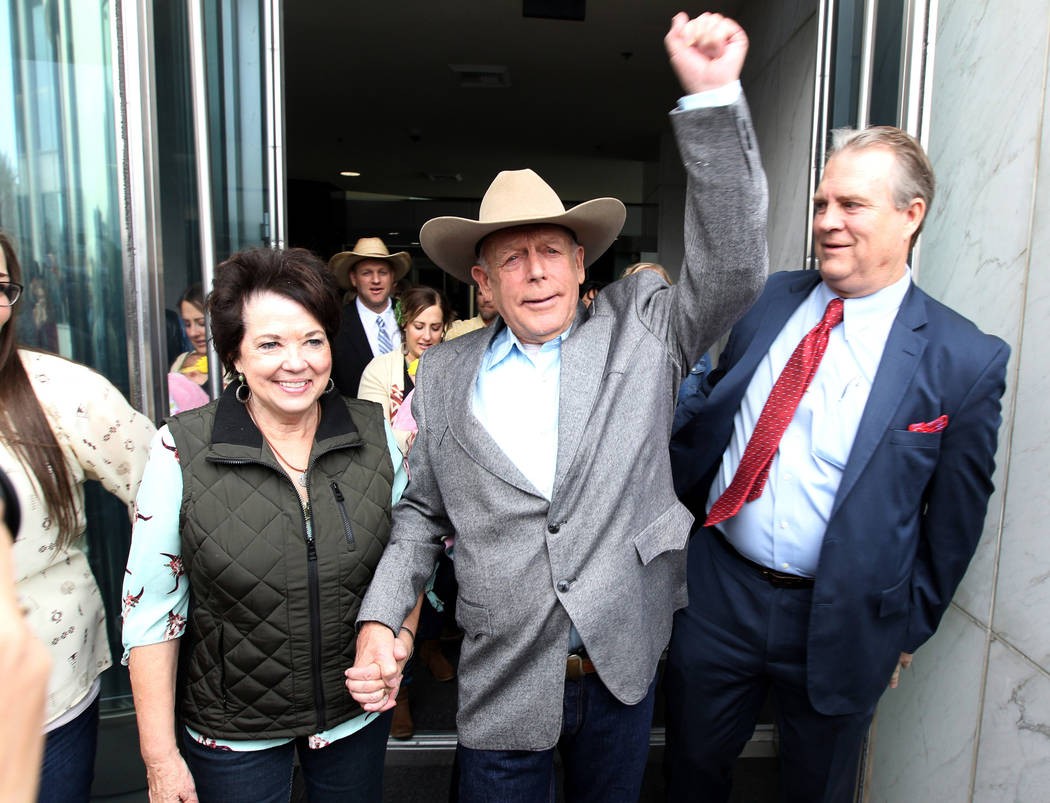 Cliven Bundy walks out of the Lloyd George U.S. Courthouse in Las Vegas a free man with his wife, Carol, on Monday, Jan. 8, 2018. At rear, in a cowboy hat, is their son Ammon Bundy. K.M. Cannon La ...