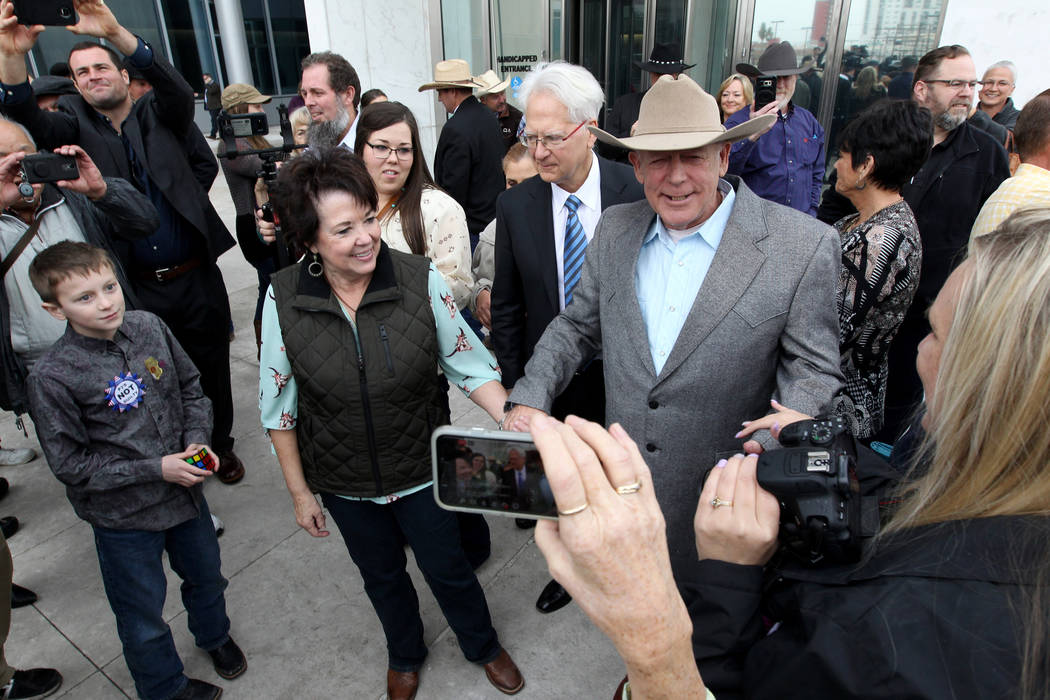Cliven Bundy walks out of the Lloyd George U.S. Courthouse in Las Vegas a free man with his wife, Carol, on Monday, Jan. 8, 2018, after a federal judge dismissed the case against him, two of his s ...