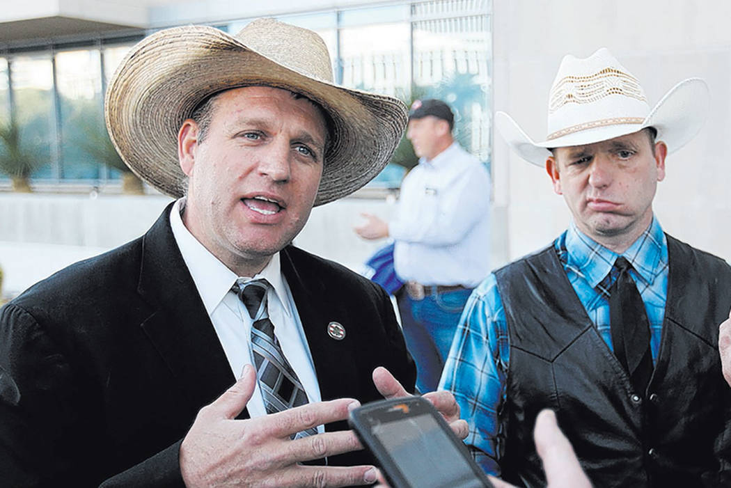 Defendants Ammon Bundy, left, and his brother Ryan Bundy, talk to the news media outside the Lloyd George U.S. Courthouse Wednesday, Dec. 20, 2017, after a mistrial was declared in the Bunkerville ...