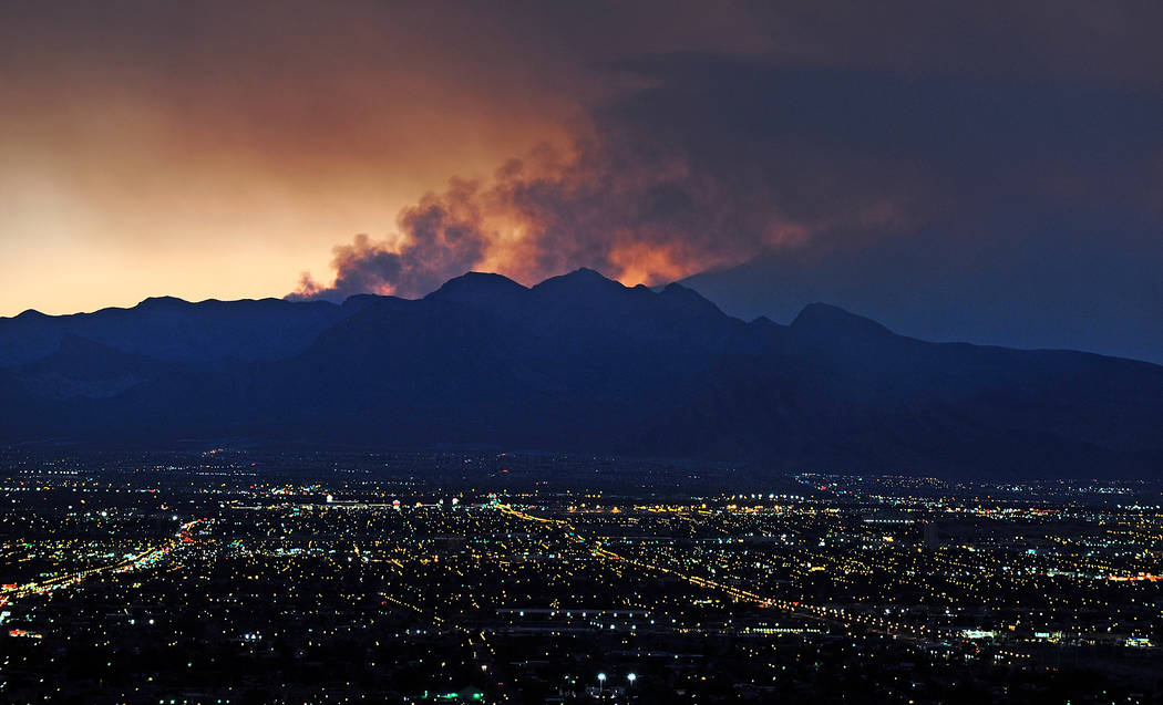 Smoke rises from the Carpenter 1 wildfire as the sun sets over Las Vegas on July 9, 2013. (David Becker/Las Vegas Review-Journal)