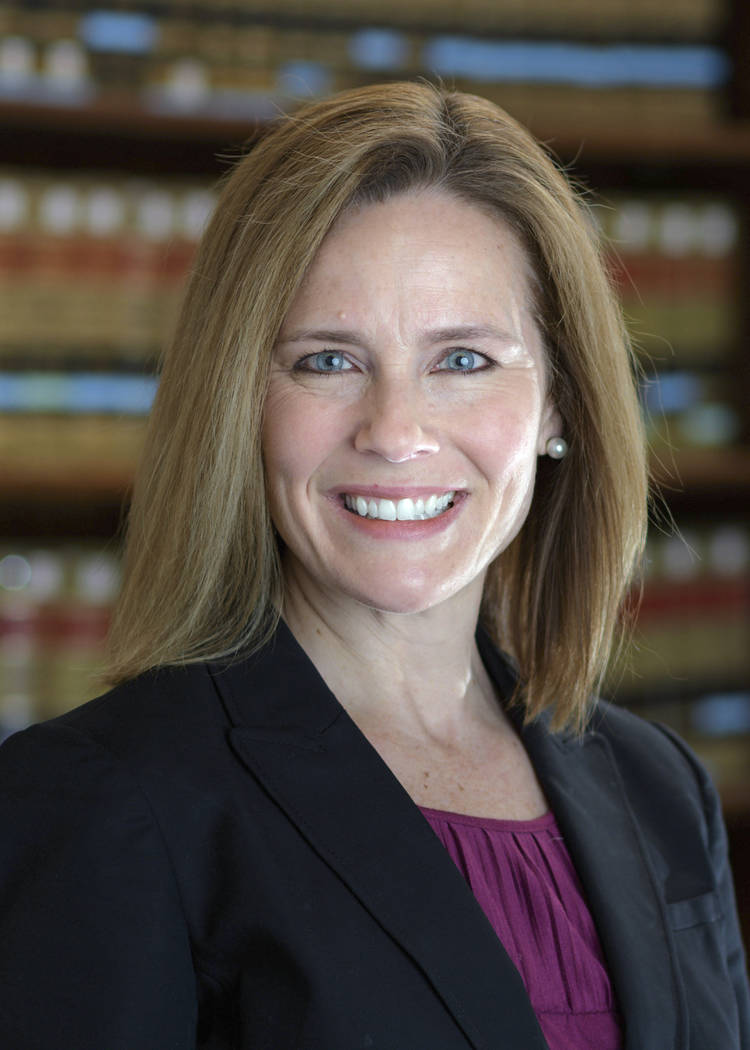 This 2017 photo provided by the University of Notre Dame Law School in South Bend, Ind., shows Judge Amy Coney Barrett. Barrett is on President Donald Trump's list of potential Supreme Court Justi ...