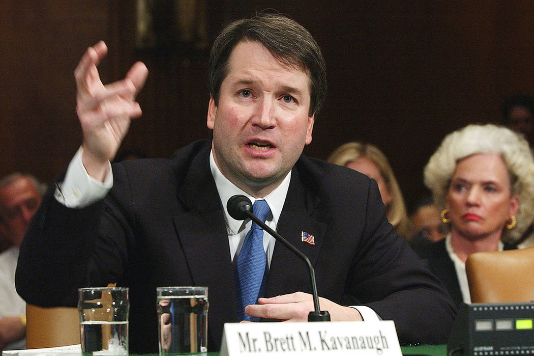In this April 26, 2004, photo, Brett Kavanaugh appears before the Senate Judiciary Committee on Capitol Hill in Washington. (AP Photo/Dennis Cook, File)