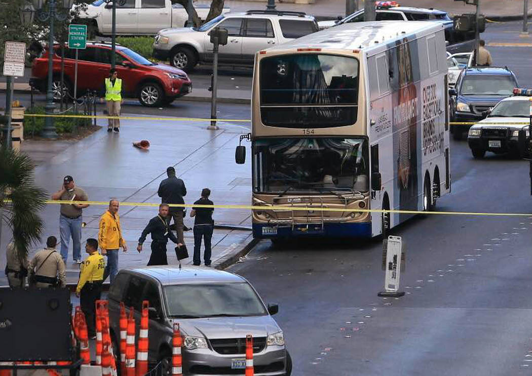 Police investigate a shooting on an RTC bus that left one person dead and one injured outside The Cosmopolitan of Las Vegas on March 25, 2017. The suspect in the shooting surrendered to police aft ...