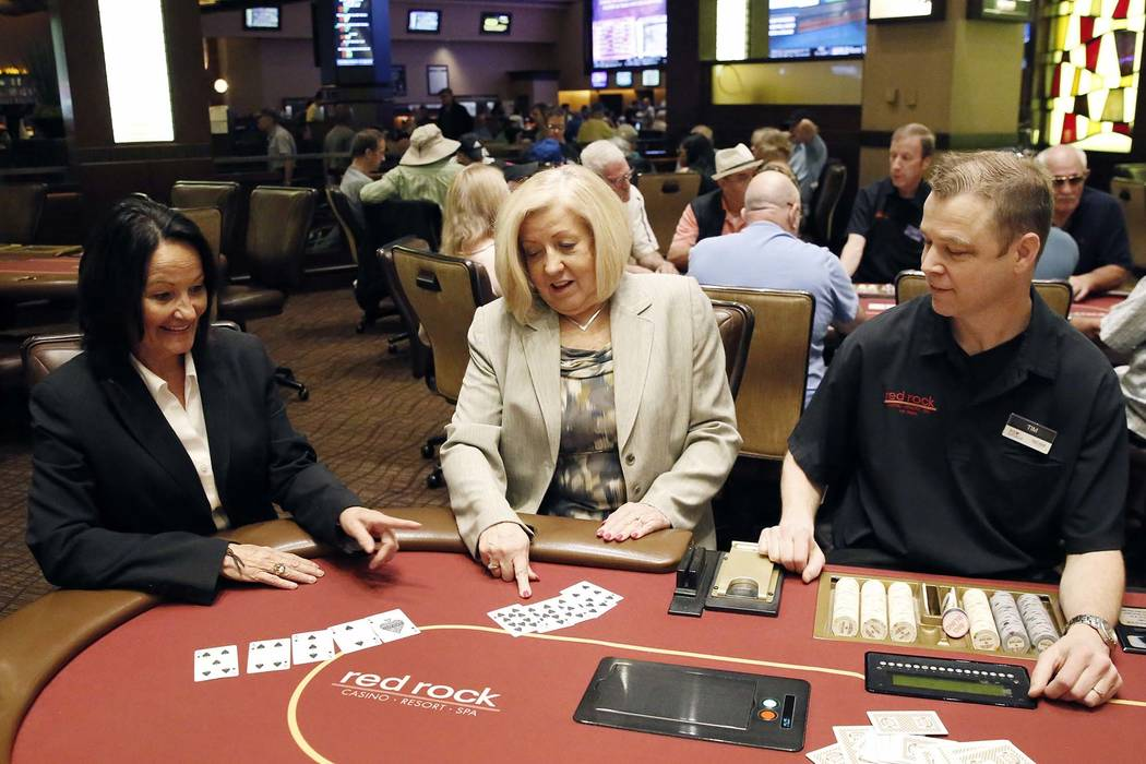 Tracy Mendiola, left, and Kathy Raymond, poker rooms managers for Station Casinos, sort a deck of playing cards as Tim Mitchell, poker dealer, looks on at Red Rock Resort on Tuesday, July 10, 2018 ...
