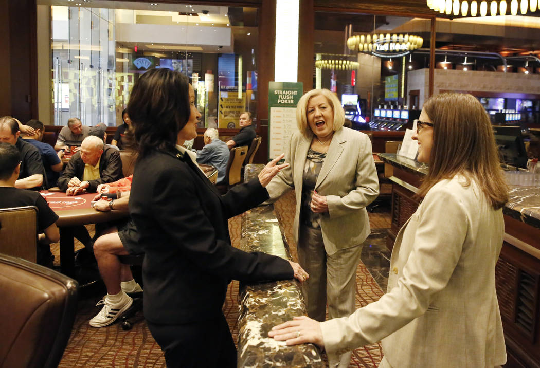 Tracy Mendiola, left, and Kathy Raymond, center, both poker rooms managers at the Station Casinos, chat with Carrie Jacobs, poker shift manager, at the Red Rock Resort's poker room on Tuesday, Jul ...