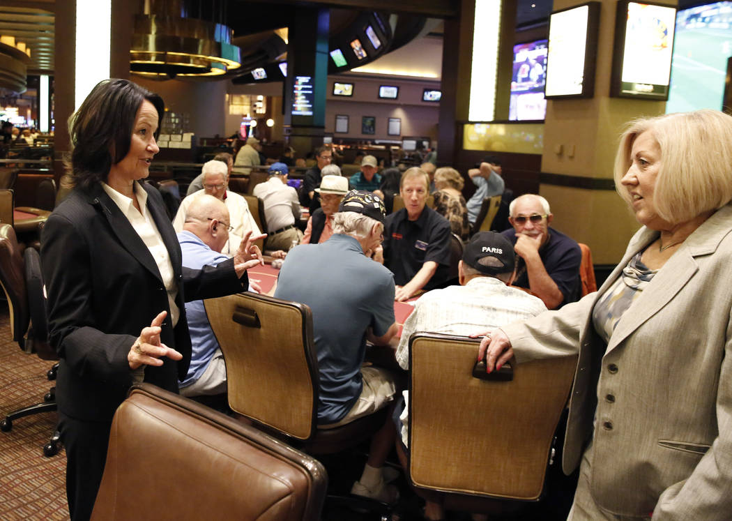 Tracy Mendiola, left, talks to Kathy Raymond, right, both poker rooms managers at the Station Casinos, at the Red Rock Resort's poker room on Tuesday, July 10, 2018, in Las Vegas. Bizuayehu Tesfay ...