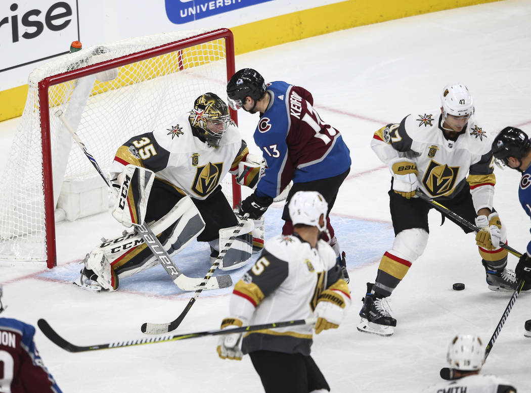 Golden Knights' Oscar Dansk (35) defends as Colorado Avalanche attacks during an NHL hockey game at T-Mobile Arena in Las Vegas on Friday, Oct. 27, 2017. Chase Stevens Las Vegas Review-Journal @cs ...