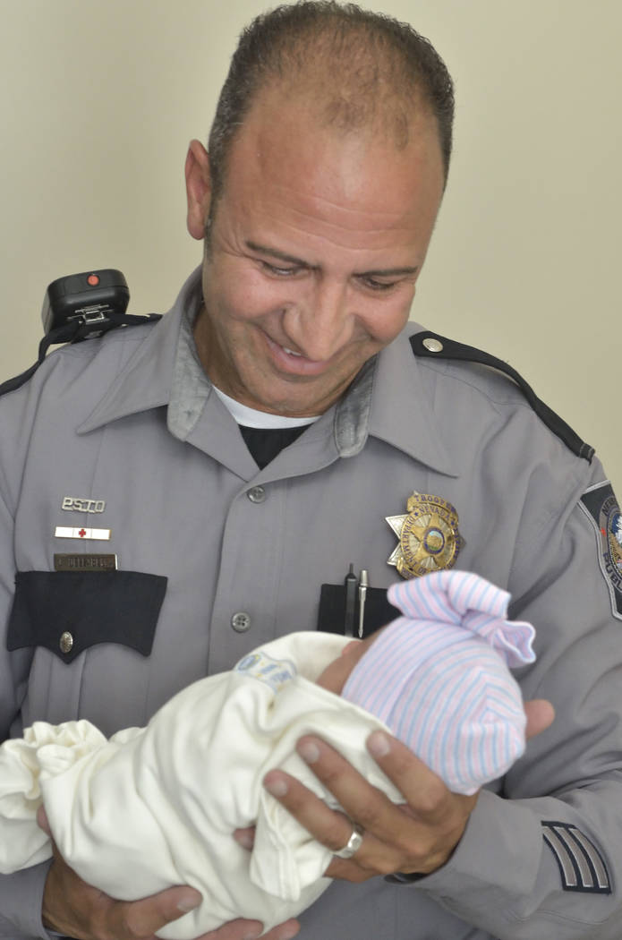 Nevada Highway Patrol trooper Joseph DellaBella holds Bianca Garcia-Velasquez at Sunrise Children's Hospital at 3186 S. Maryland Parkway on Friday, July 7, 2018. DellaBella delivered the ba ...