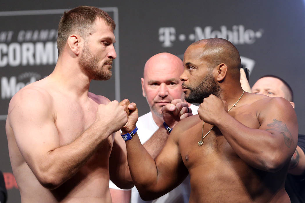 Stipe Miocic, left, and Daniel Cormier during the UFC 226 ceremonial weigh-in event at T-Mobile Arena in Las Vegas, Friday, July 6, 2018. Erik Verduzco Las Vegas Review-Journal @Erik_Verduzco