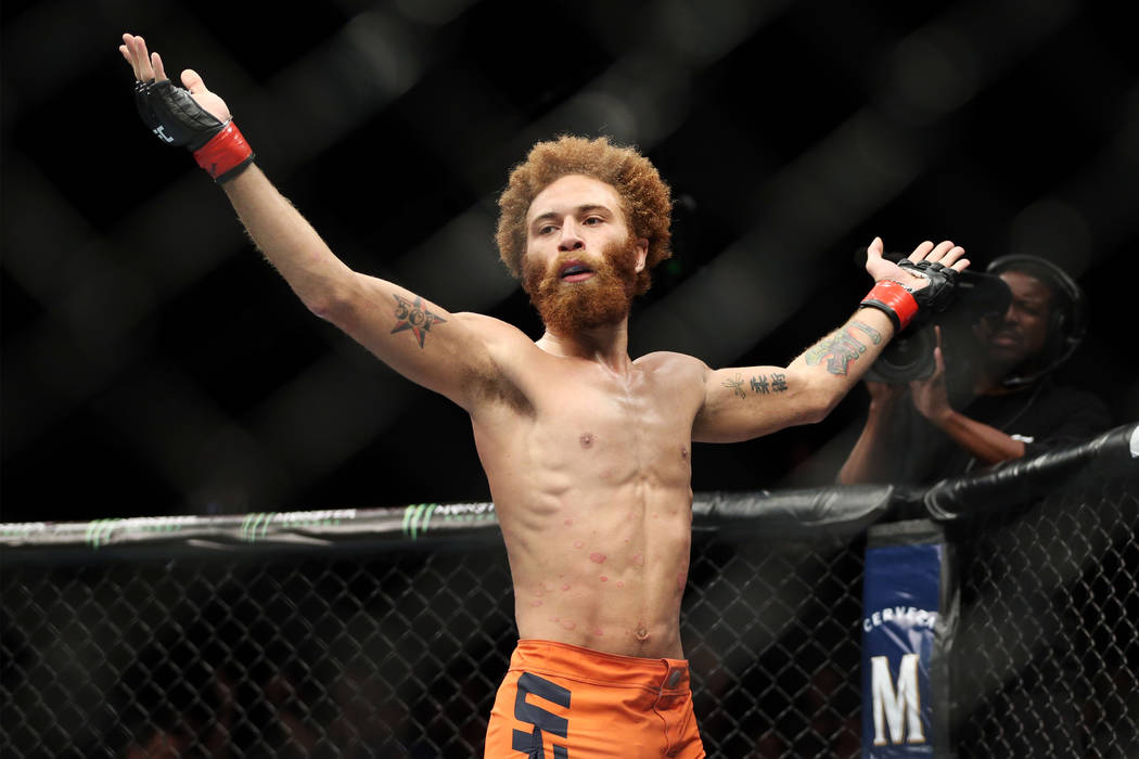 Luis Pena reacts after his first round submission win against Richie Smullen in the lightweight bout during the The Ultimate Fighter 27 Finale at the Palms casino-hotel in Las Vegas, Friday, July ...
