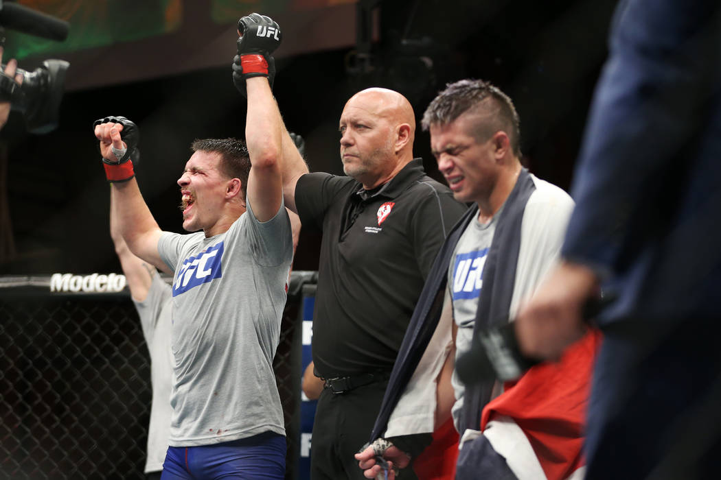 John Gunther reacts to his majority win against Allan Zuniga in the lightweight bout during the The Ultimate Fighter 27 Finale at the Palms casino-hotel in Las Vegas, Friday, July 6, 2018. Gunther ...