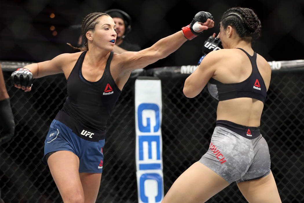 Montana De La Rosa, left, throws a punch against Rachael Ostovich in the women's flyweight bout in Las Vegas, Friday, July 6, 2018. De La Rosa won by way of submission in the third round. Erik Ver ...