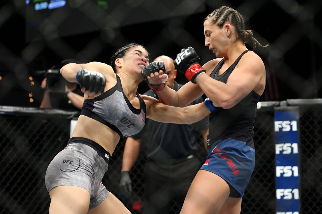 Montana De La Rosa, right, connects a punch against Rachael Ostovich in the women's flyweight bout in Las Vegas, Friday, July 6, 2018. De La Rosa won by way of submission in the third round. Erik ...